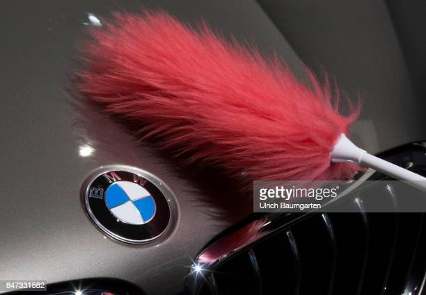 International Motor Show 2017 in Frankfurt Hand with a feather cluster cleans the BMW logo