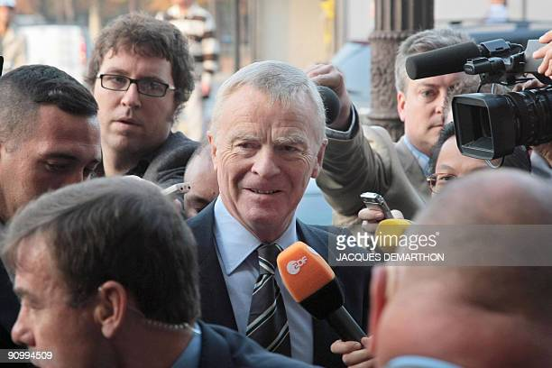 International Motoring Federation president Max Mosley answers journalists as he arrives at the FIA headquarters in Paris on September 21 2009 for an...