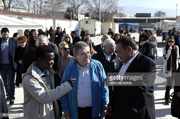 International Olympic Committee chairman Thomas Bach visits the Elaionas camp for migrants and refugees in Athens on January 28 2016 The facility...