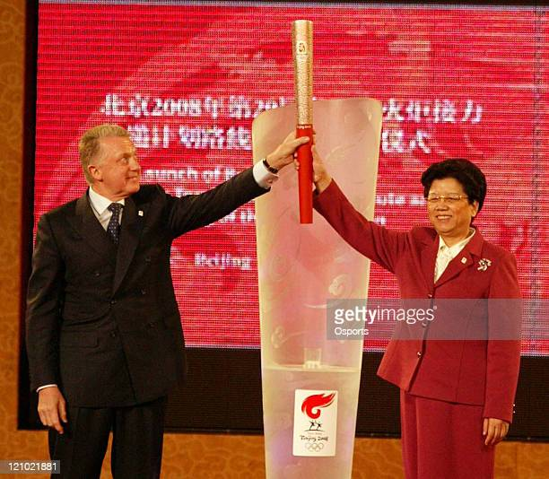 International Olympic Committee Coordination Commission Chairman Hein Verbruggen and Chinese State Councillor Chen Zhili hold up the Beijing Olympic...