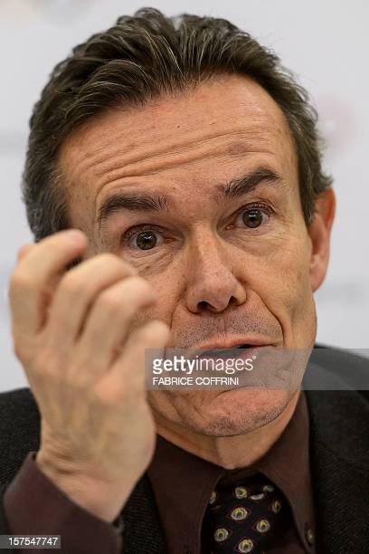 International Olympic Committee director of relations with national Olympic committees Pere Miro gestures during a press conference on December 4...