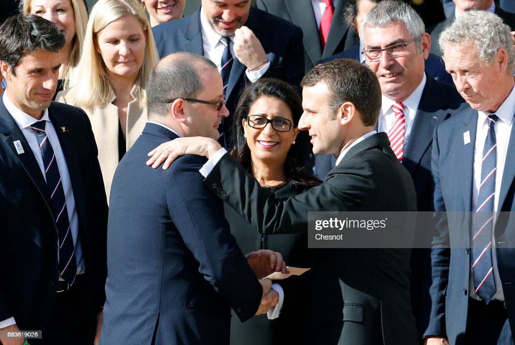 International Olympic Committee Evaluation Commission Chair, Patrick Baumann shakes hands with new French President Emmanuel Macron after a family photo at the Elysee Presidential Palace on May 16, 2017 in Paris, France. The cities of Paris and Los Angeles are currently bidding to host the 2024 Olympic Games.