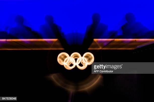 TOPSHOT International Olympic Committee Excutive members are seen in silhouette during the 131st IOC session in Lima on September 15 2017 / AFP PHOTO...