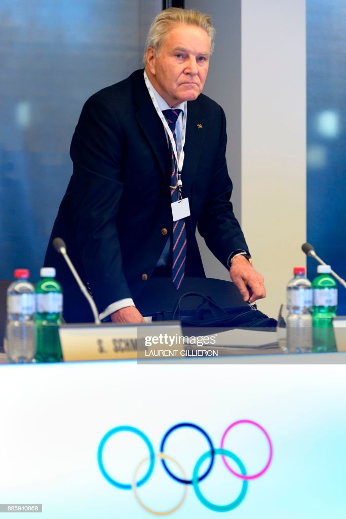 International Olympic Committee (IOC) member Denis Oswald of Switzerland arrives for the opening session of the first day of the executive board meeting of the International Olympic Committee (IOC) at the IOC headquarters, in Pully near Lausanne, on December 5, 2017. /