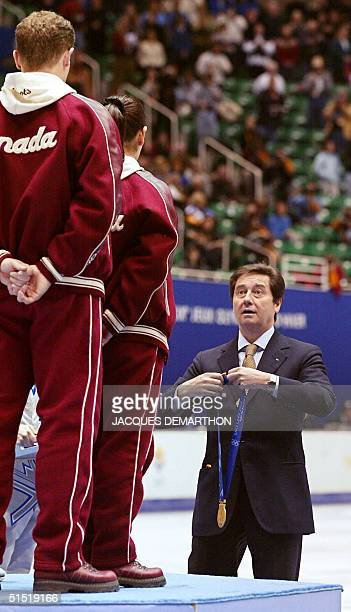 International Olympic Committee member from Italy and president of the international skating union Ottavio Cinquanta awards the gold medal to...