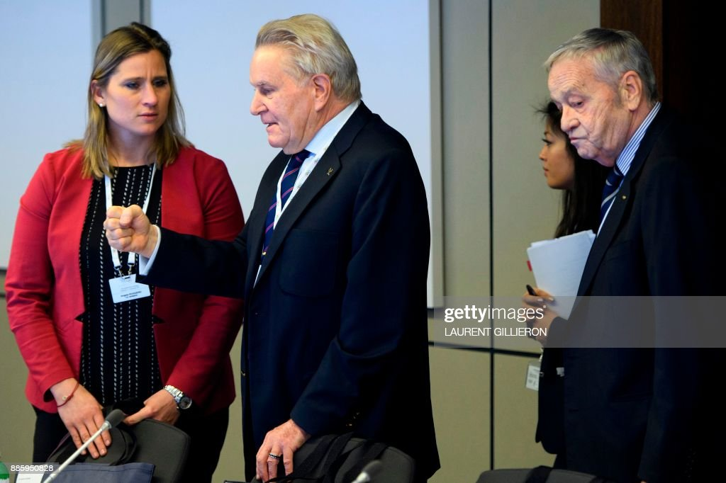 International Olympic Committee (IOC) members Denis Oswald (C) of Switzerland speaks with Angela Ruggiero (L) from the United States, next to Gian-Franco Kasper (R) from Switzerland, prior to the opening of the first day of the executive board meeting of the International Olympic Committee (IOC) at the IOC headquarters, in Pully near Lausanne, on December 5, 2017. The International Olympic Committee meets to decide whether to bar Russia from the 2018 Winter Olympics for doping violations, in one of the weightiest decisions ever faced by the Olympic movement. /