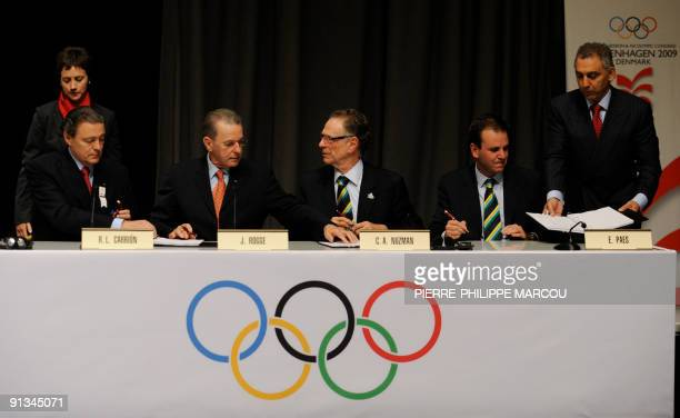 International Olympic Committee President Jacques Rogge, Rio de Janeiro 2016 President Carlos Nuzman and Rio Mayor Eduardo Paes rejoice after signing...