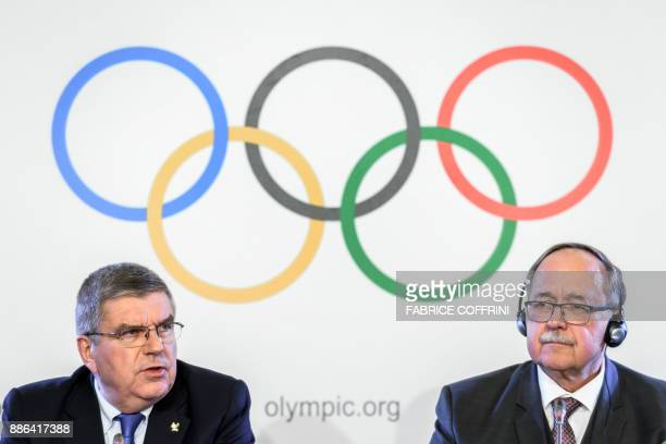International Olympic Committee President Thomas Bach and Chair of IOC Inquiry Commission into alleged Russian doping at Sochi 2014 Swiss Samuel...