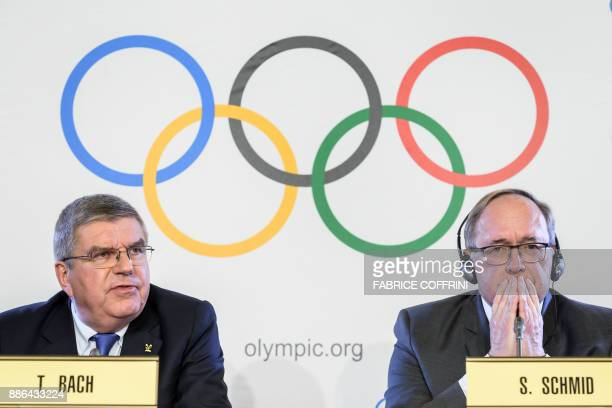 TOPSHOT International Olympic Committee President Thomas Bach and Chairman of IOC Inquiry Commission into alleged Russian doping at Sochi 2014 Swiss...