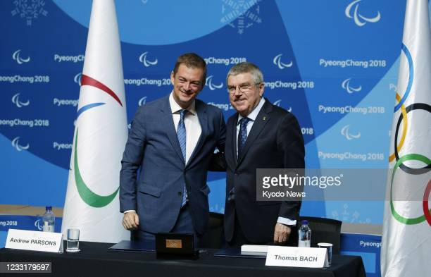 International Olympic Committee President Thomas Bach and his International Paralympic Committee counterpart Andrew Parsons pose for a photo during a...