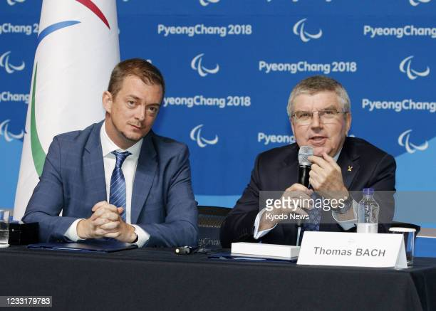 International Olympic Committee President Thomas Bach and his International Paralympic Committee counterpart Andrew Parsons attend a press conference...