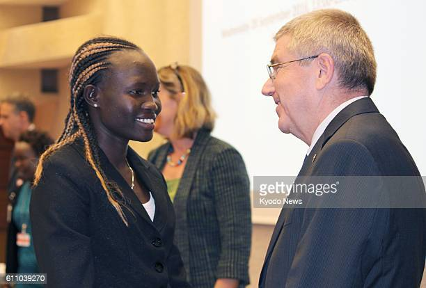 International Olympic Committee President Thomas Bach and Rose Nathike Lokonyen, who represented the refugee team in the women's 800 meters at the...