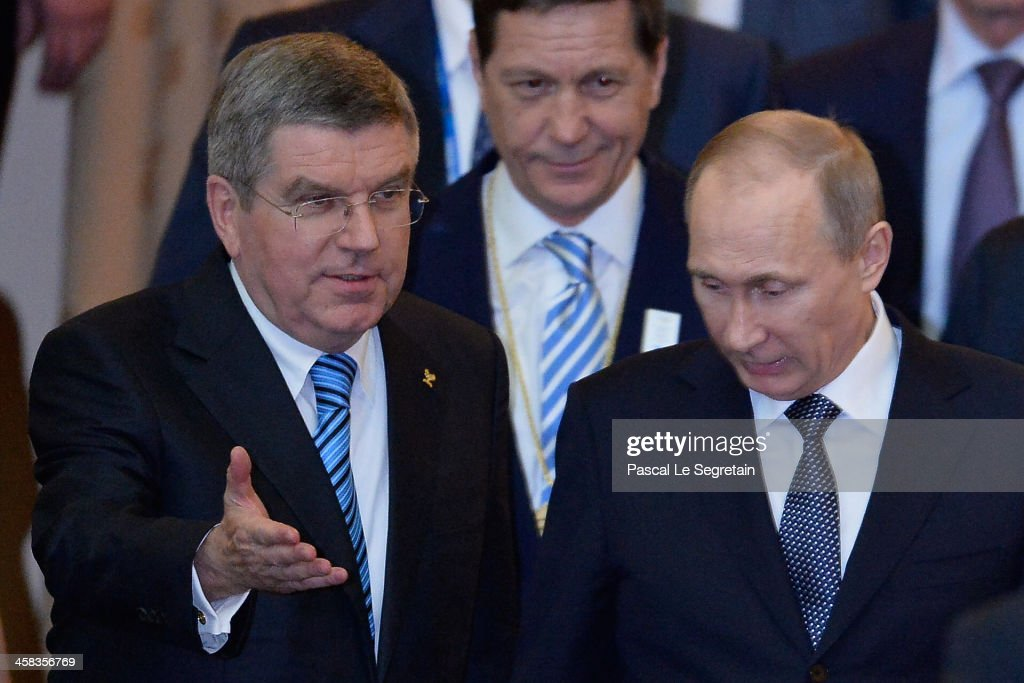 International Olympic Committee President Thomas Bach (L) and Russian President Vladimir Putin (R) arrive to attend the opening of the I.O.C session at Zemni theater on February 4, 2014 in Sochi, Russia.