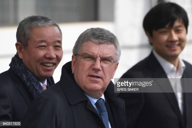 International Olympic Committee President Thomas Bach arrives at Beijing airport after a flight from North Korea on March 31 2018 North Korea's...
