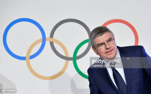 International Olympic Committee President Thomas Bach arrives to a press conference closing an IOC executive meeting on December 6 2017 in Lausanne...