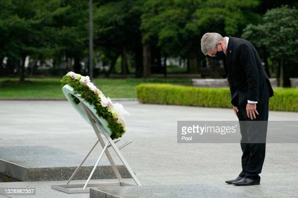International Olympic Committee President Thomas Bach bows after offering a wreath to the cenotaph at the Hiroshima Peace Memorial Park on July 16,...