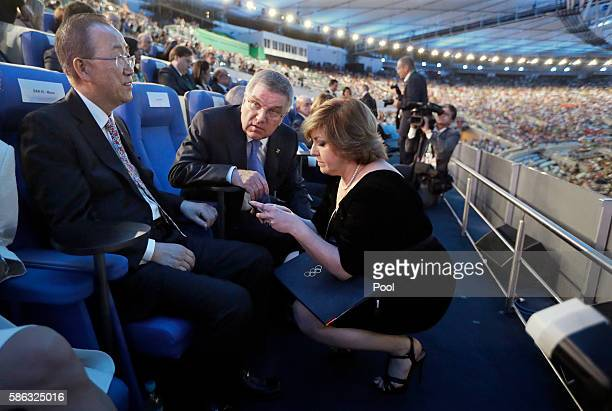 International Olympic Committee President Thomas Bach center talks with Marina Baramia the IOC chief of protocol right before the opening ceremony...