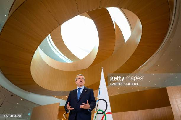 International Olympic Committee President Thomas Bach delivers a statement on the COVID-19 situation during a meeting of the executive board at the...