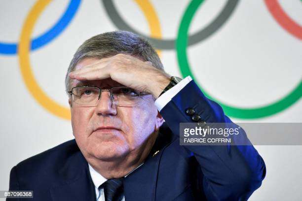 International Olympic Committee President Thomas Bach gestures during a press conference closing an IOC executive meeting on December 6 2017 in...