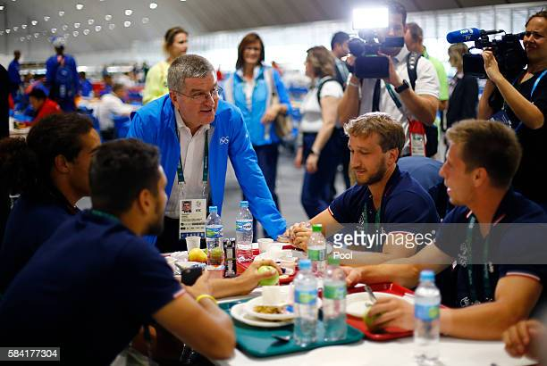 International Olympic Committee President Thomas Bach greets athletes at lunch after moving into the Olympic village in Rio de Janeiro, Brazil, July...
