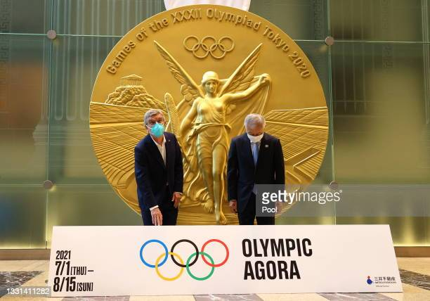 International Olympic Committee President Thomas Bach is escorted by Mitsui Fudosan Group President and CEO Masanobu Komoda in front of a large-scale...
