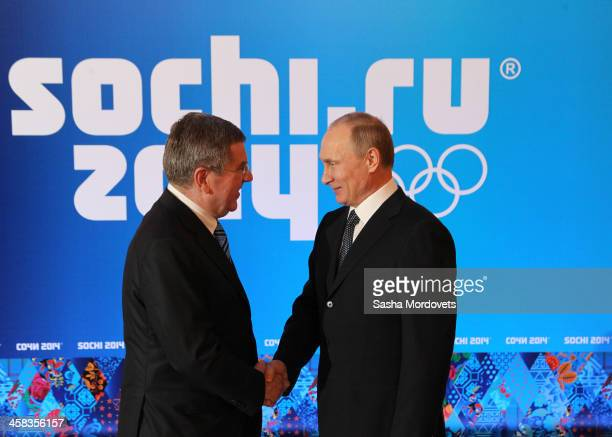 International Olympic Committee President Thomas Bach is greeted by Russian President Vladimir Putin at a welcoming event for IOC members ahead of...