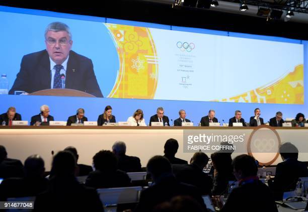 International Olympic Committee President Thomas Bach is seen on a giant screen during an IOC meeting prior the Pyeongchang 2018 Winter Olympic Games...