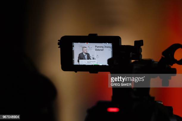 International Olympic Committee President Thomas Bach is seen on a camera screen as he speaks at the opening session of the Pyongchang 2018 Debrief...