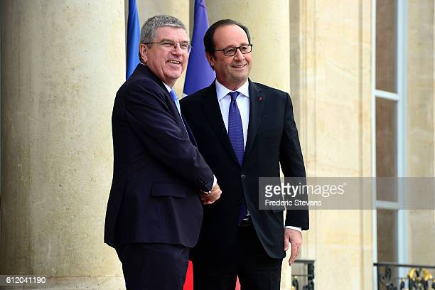 International Olympic Committee President Thomas Bach meets with French President Francois Hollande at Elysee Palace to discuss Paris bid for the...