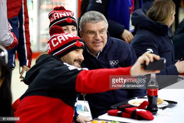 International Olympic Committee President Thomas Bach poses for a selfie with members of the Canadian Olympic Team during a tour of the Olympic...