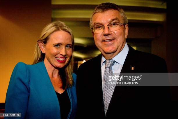 International Olympic Committee president Thomas Bach poses with Queensland state Sports Minister Kate Jones after the opening of 17th edition of the...