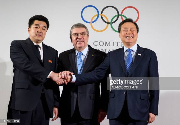 TOPSHOT International Olympic Committee President Thomas Bach poses with North Korea's Sports Minister and Olympic Committee president Kim Il Guk and...
