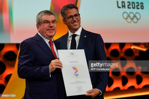 International Olympic Committee President Thomas Bach poses with the chairman of the Los Angeles 2028 bid Casey Wasserman after Los Angeles was...