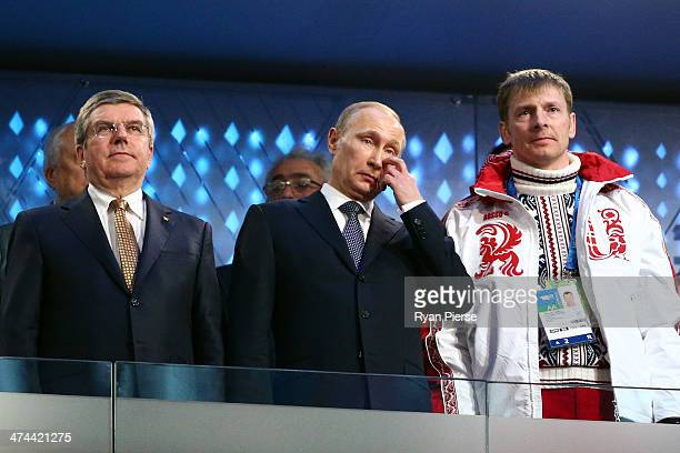 International Olympic Committee President Thomas Bach President of Russia Vladimir Putin and double bobsleigh gold medalist Alexander Zubkov of...