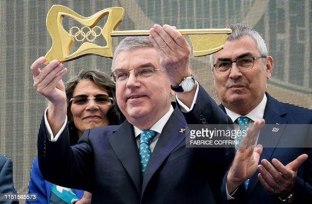 International Olympic Committee president Thomas Bach raises the new key during the inauguration ceremony of the Olympic house the new IOC...
