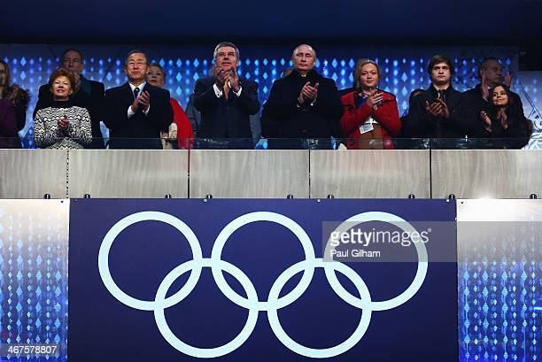 International Olympic Committee President Thomas Bach Russian President Vladimir Putin and Claudia Bach attend the Opening Ceremony of the Sochi 2014...
