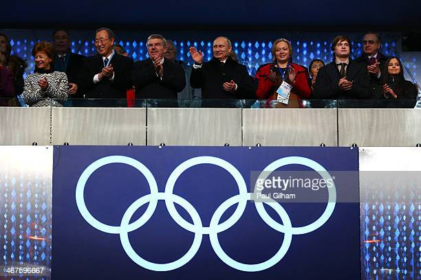 International Olympic Committee President Thomas Bach , Russian President Vladimir Putin and Claudia Bach attend the Opening Ceremony of the Sochi...