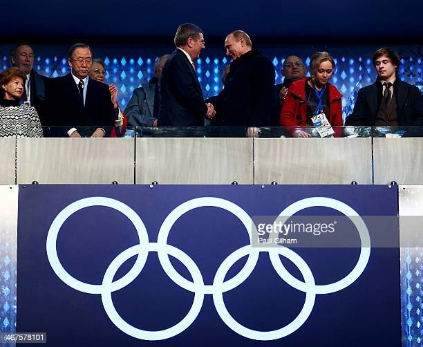 International Olympic Committee President Thomas Bach shakes hands with Russian President Vladimir Putin during the Opening Ceremony of the Sochi...