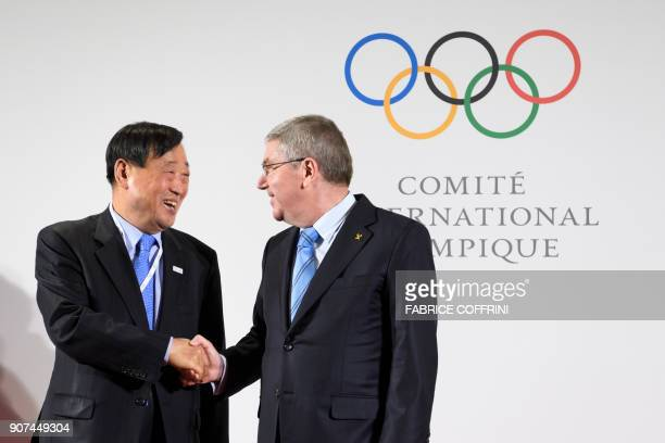International Olympic Committee President Thomas Bach shakes hands with PyeongChang 2018 Olympics President Lee Heebeom before the North and South...