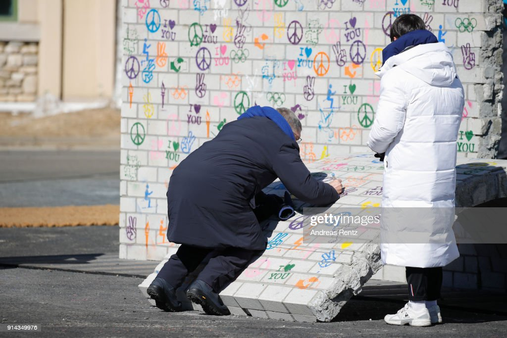 International Olympic Committee (IOC) President Thomas Bach signs on a piece of the 'Building Bridges' mural during the inauguration of the Olympic truce mural during previews ahead of the PyeongChang 2018 Winter Olympic Games on February 5, 2018 in Pyeongchang-gun, South Korea.