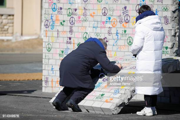 International Olympic Committee President Thomas Bach signs on a piece of the 'Building Bridges' mural during the inauguration of the Olympic truce...