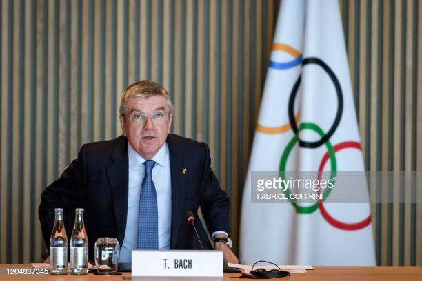 International Olympic Committee President Thomas Bach speaks at the opening of a meeting of the executive board at the IOC headquarters in Lausanne...
