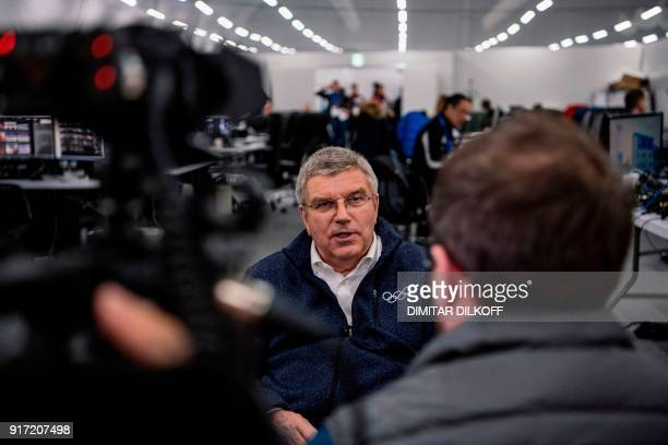 International Olympic Committee president Thomas Bach speaks with journalists during a visit to the AFP office at the Pyeongchang 2018 Winter Olympic...