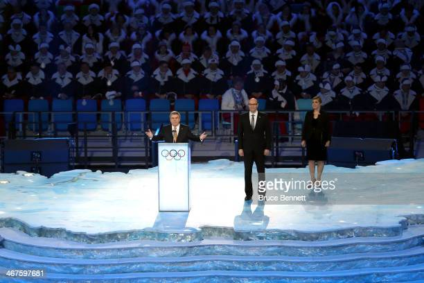 International Olympic Committee President Thomas Bach talks as Sochi 2014 Organizing Committee President and CEO Dmitriy Chernyshenko looks on during...
