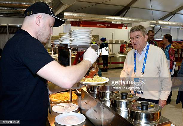 International Olympic Committee President Thomas Bach waits for his lunch in the Athletes Olympic Village prior to the Sochi 2014 Winter Olympics on...