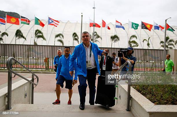 International Olympic Committee President Thomas Bach walks with his luggage as he moves into the Olympic village in Rio de Janeiro Brazil July 28...
