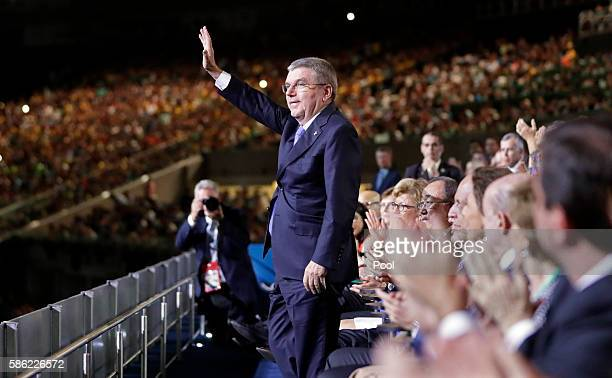 International Olympic Committee President Thomas Bach waves as he is introduced during the opening ceremony for the 2016 Summer Olympics on August 5...