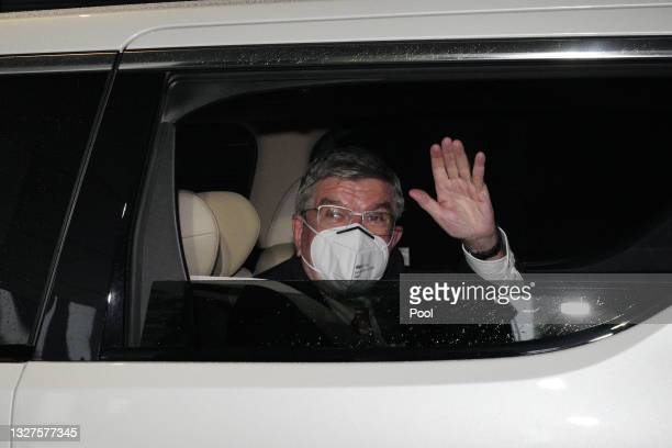 International Olympic Committee president Thomas Bach waves to media as he arrives at an accommodation ahead of the delayed Tokyo Olympic Games on...