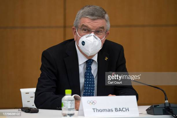 International Olympic Committee President Thomas Bach wears a face mask as he speaks during a press conference on November 16, 2020 in Tokyo, Japan....