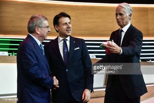 International Olympic Committee president Thomas Bach welcomes Italian Prime Minister Giuseppe Conte and Italian National Olympic Commitee president...